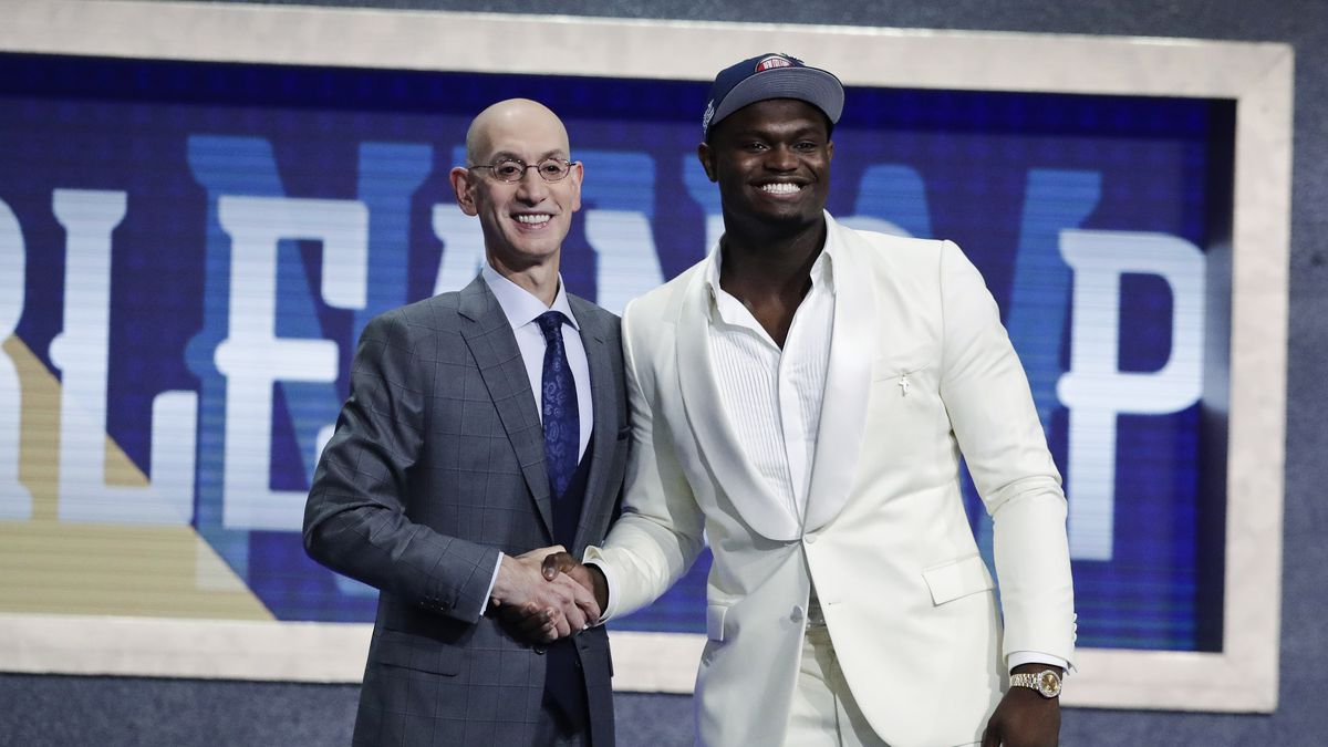 Duke's Zion Williamson, right, poses for photographs with NBA Commissioner Adam Silver after being selected by the New Orleans Pelicans as the first pick during the NBA basketball draft Thursday, June 20, 2019, in New York. | Photo Source: AP Photo / Julio Cortez