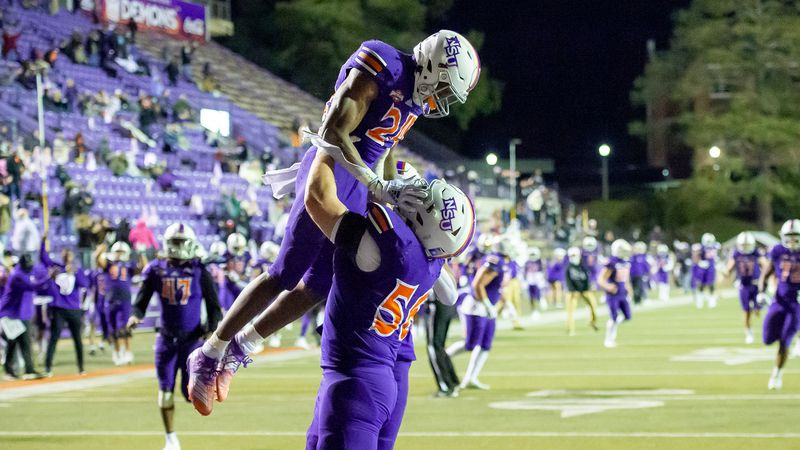 NSU offensive lineman Kenny Sheldon lifts running back Aubrey Scott into the air after Scott...