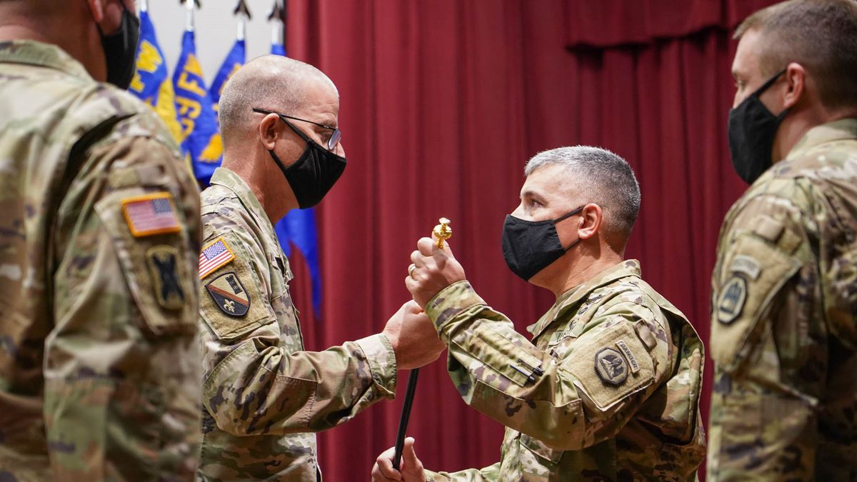 Command Sgt. Major Clifford Ockman Jr. receives the Noncommissioned Officer Sword from Brig....