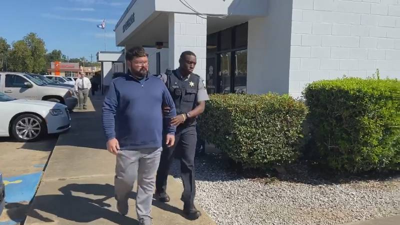 Dustin Parra, a Pineville resident charged with the murder of his wife in 2014, being escorted...
