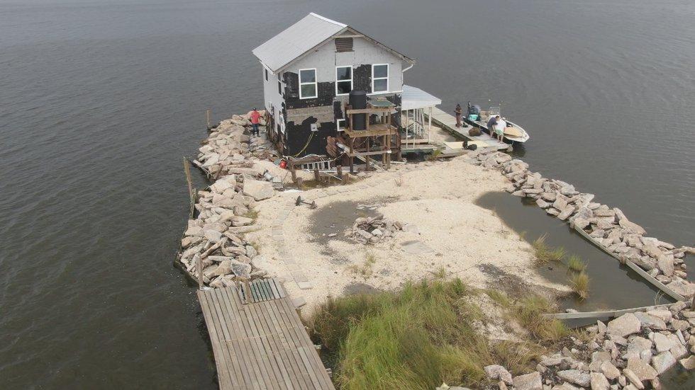 "Christian Amedee's ""island paradise"" along the Wilkinson Canal, damaged in Hurricane Ida"