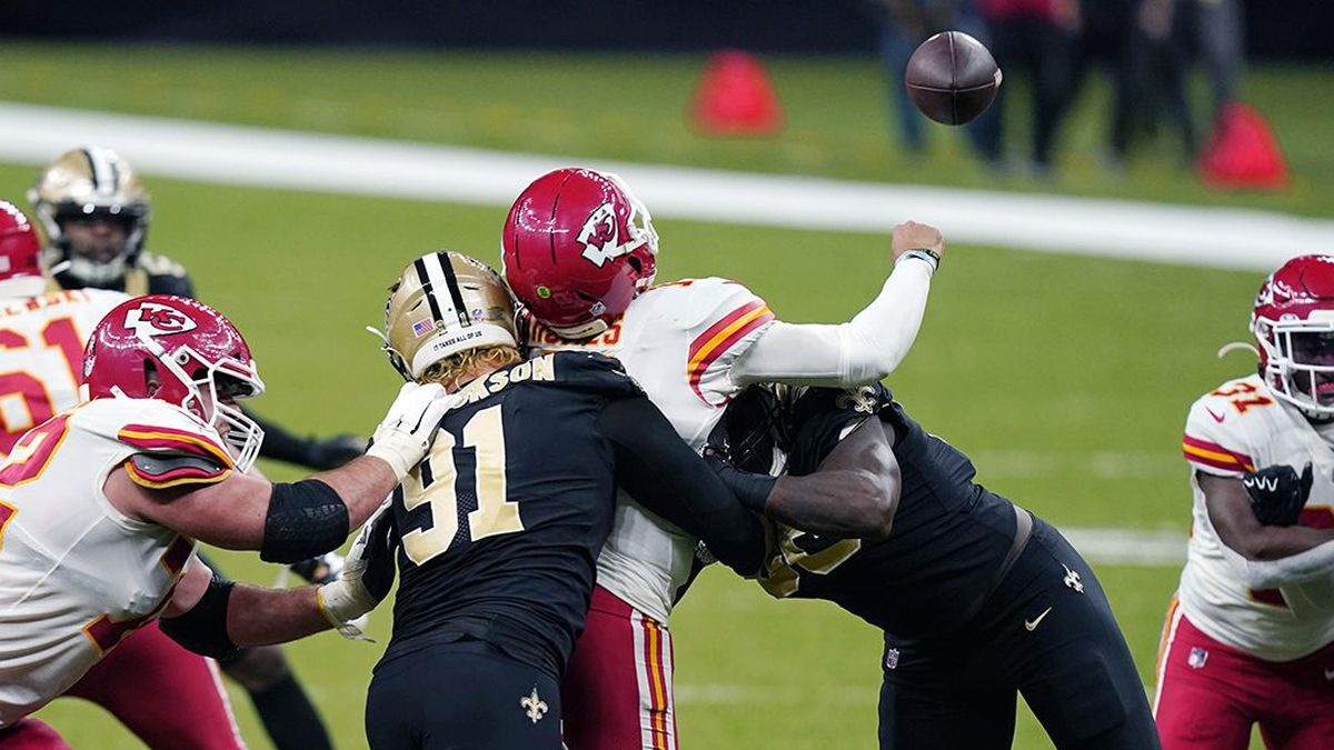 Kansas City Chiefs quarterback Patrick Mahomes (15) fumbles as he is sacked by New Orleans...