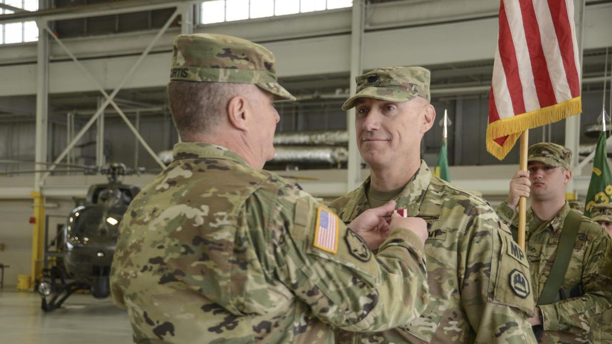 Maj. Gen. Glenn H. Curtis, adjutant general of the Louisiana National Guard, pins a Meritorious Service Medal on Lt. Col. Richard Douget, of Baton Rouge, Louisiana, during an official change of command ceremony at Esler Field in Pineville, Louisiana, Jan. 13, 2019. During the ceremony, Douget relinquished command of the 773rd Military Police Battalion to Lt. Col. Mark McCoy, of Winnfield, Louisiana. (U.S. Army National Guard photo by Sgt. Noshoba Davis)