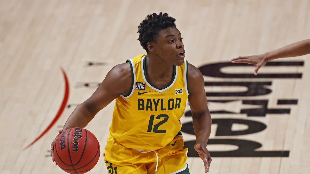 Baylor's Moon Ursin (12) dribbles the ball during the second half of an NCAA college basketball...