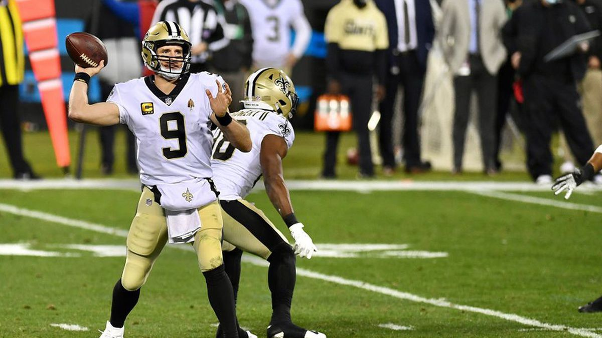Brees throws 3 TD passes at Carolina in a Saints victory.