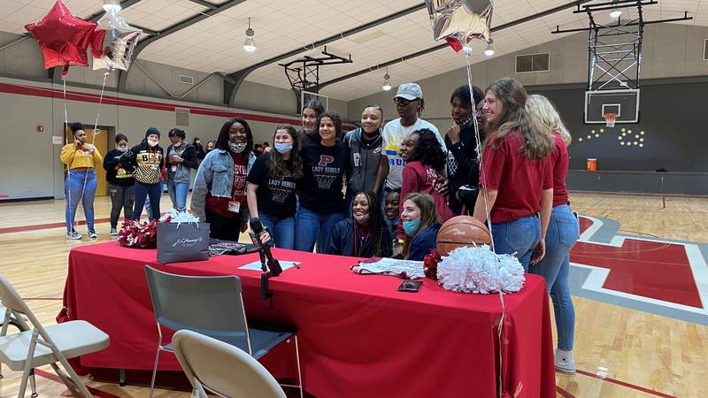 Pineville's Aylanna Winn signs the dotted lines to play basketball at Salt Lake Community...