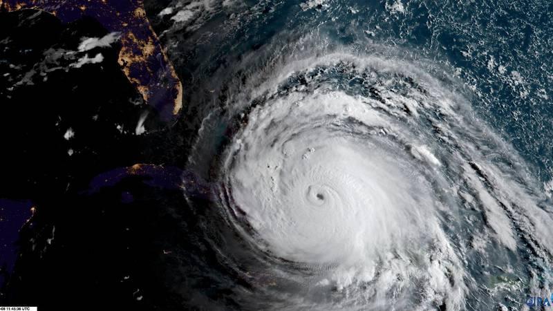 FILE - In this geocolor GOES-16 file satellite image taken Friday, Sept. 8, 2017, at 11:45 UTC,...