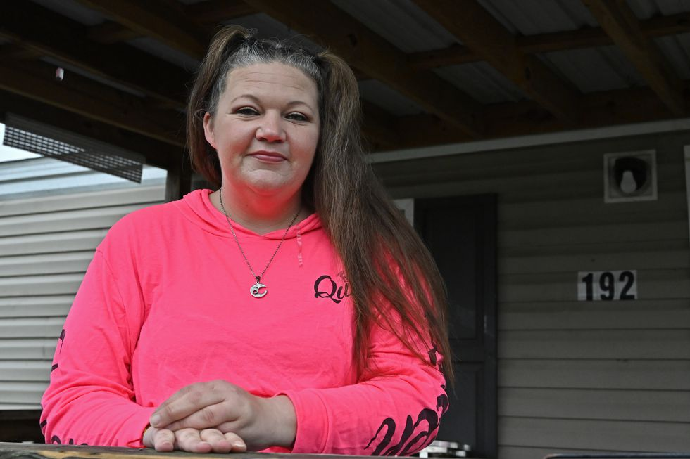 Tina Morton stands on the porch of her home in Winchester, Ky., Friday, Dec. 4, 2020. Morton,...