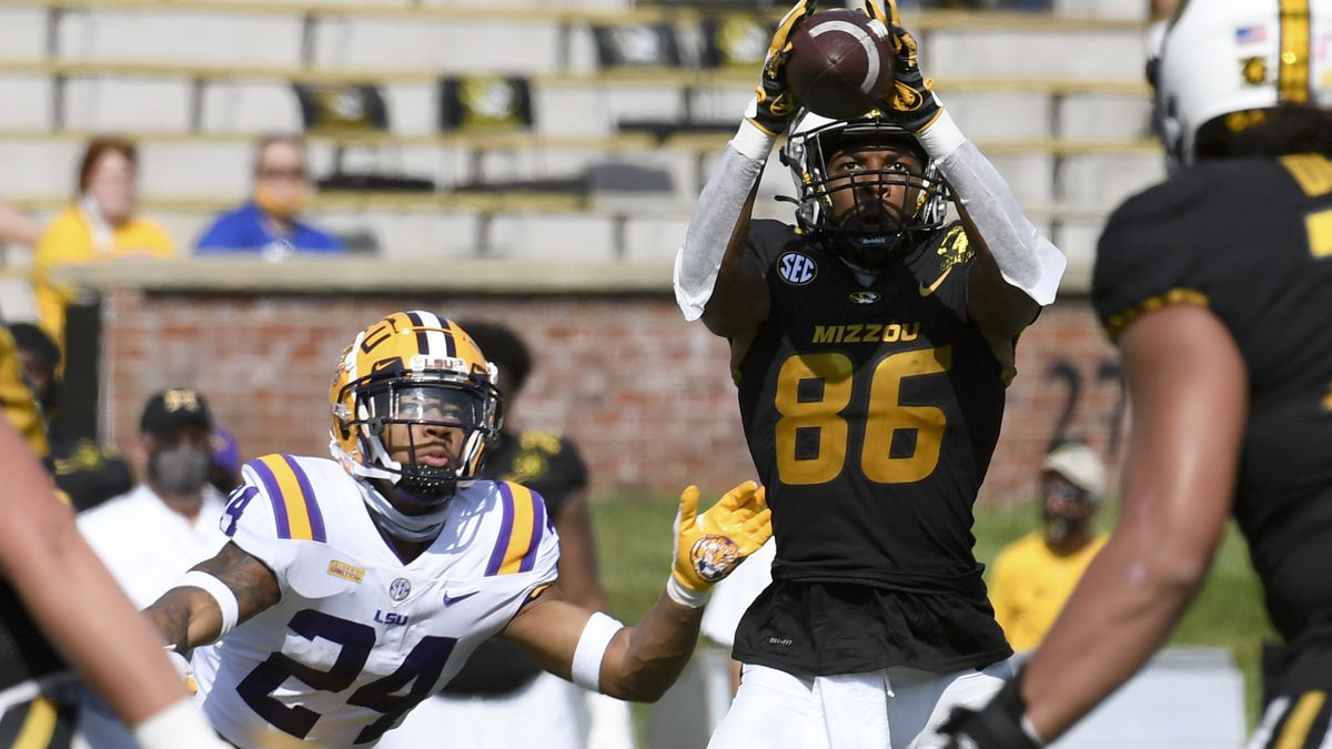 Missouri wide receiver Tauskie Dove (86) catches a pass as LSU cornerback Derek Stingley Jr. (24) defends during the first half of an NCAA college football game Saturday, Oct. 10, 2020, in Columbia, Mo. (AP Photo/L.G. Patterson)