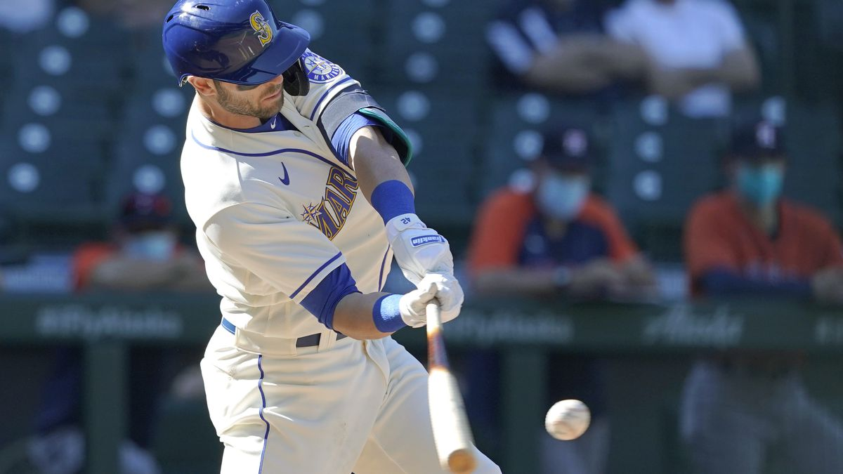 Seattle Mariners' Mitch Haniger hits an RBI-double during the seventh inning of a baseball game...