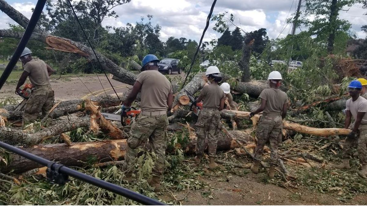 Louisiana National Guardsmen with the 527th Engineer Battalion, headquartered in Ruston, Louisiana, clean debris after tornados touched down in their community, April 25, 2019. (U.S. Army National Guard photo by Sgt. Daniel McWilliams)