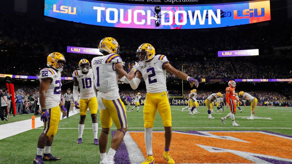 LSU wide receiver Ja'Marr Chase (1) celebrates after scoring with wide receiver Justin Jefferson during the first half of a NCAA College Football Playoff national championship game against Clemson Monday, Jan. 13, 2020, in New Orleans. | Source: AP Photo / Gerald Herbert
