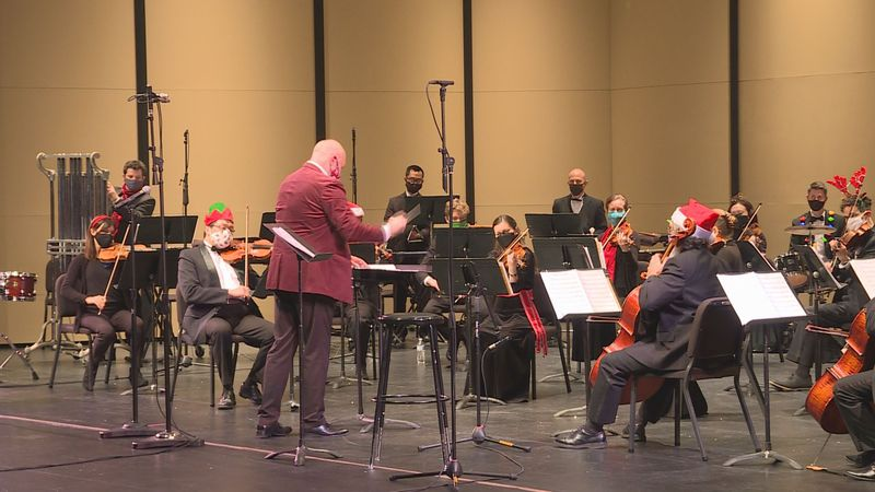 """""""This is the first concert we've done since January,"""" Joshua Zona, the conductor of the Rapides..."""