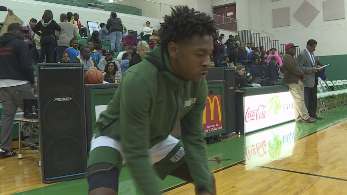 Peabody Senior Guard Melvion Flanagan dribbles a basketball, something he couldn't do a month...