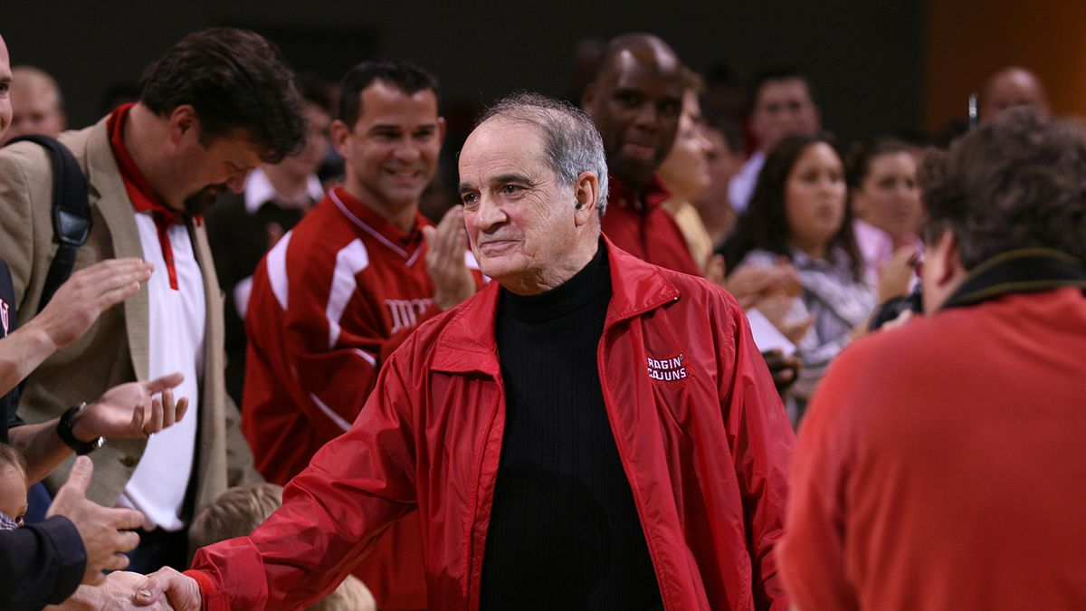 Dr. Ray P. Authement greets fans at a Ragin' Cajuns athletics event prior to his retirement as...
