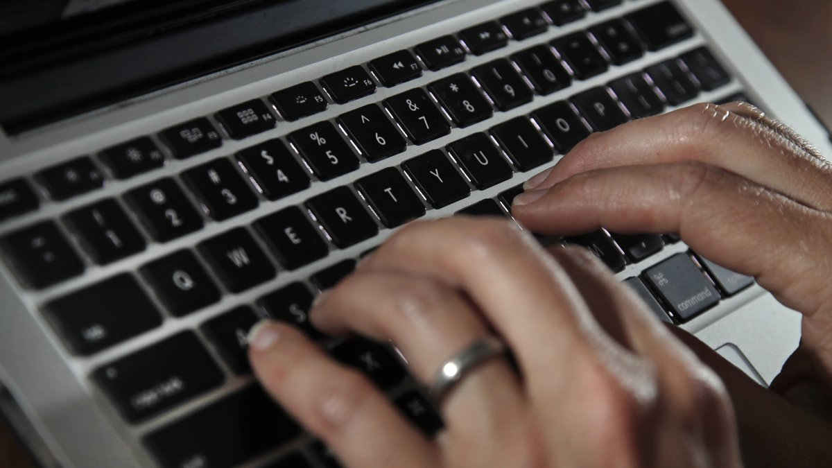 FILE: Fingers type on a laptop keyboard Monday, June 19, 2017, in North Andover, Mass.