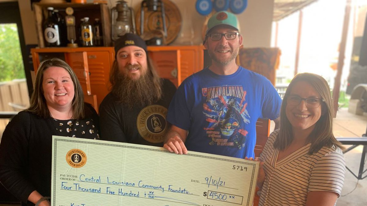 Huckleberry Brewing presenting a check to Central Louisiana Community Foundation for the Keep...