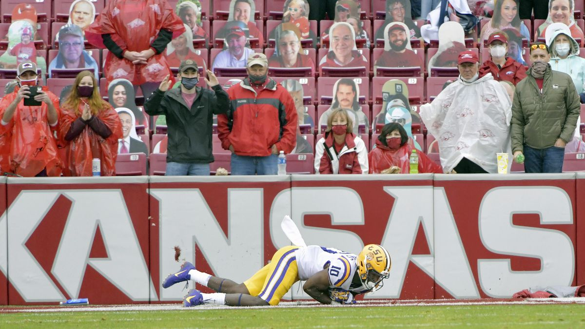 Arkansas fans react as LSU receiver Jaray Jenkins (10) catches a go-ahead touchdown pass in the...
