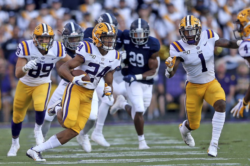 LSU Tigers cornerback Derek Stingley Jr. (24) returns a first quarter punt across field to the 34-yard line during an NCAA football game between the Georgia Southern Eagles and Louisiana State University Tigers in Baton Rouge, La., Saturday, Aug. 31, 2019. (AP Photo/Michael Democker)
