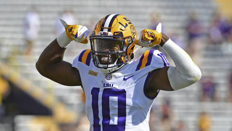 LSU wide receiver Jaray Jenkins (10) celebrates after pulling in a long reception in the first...