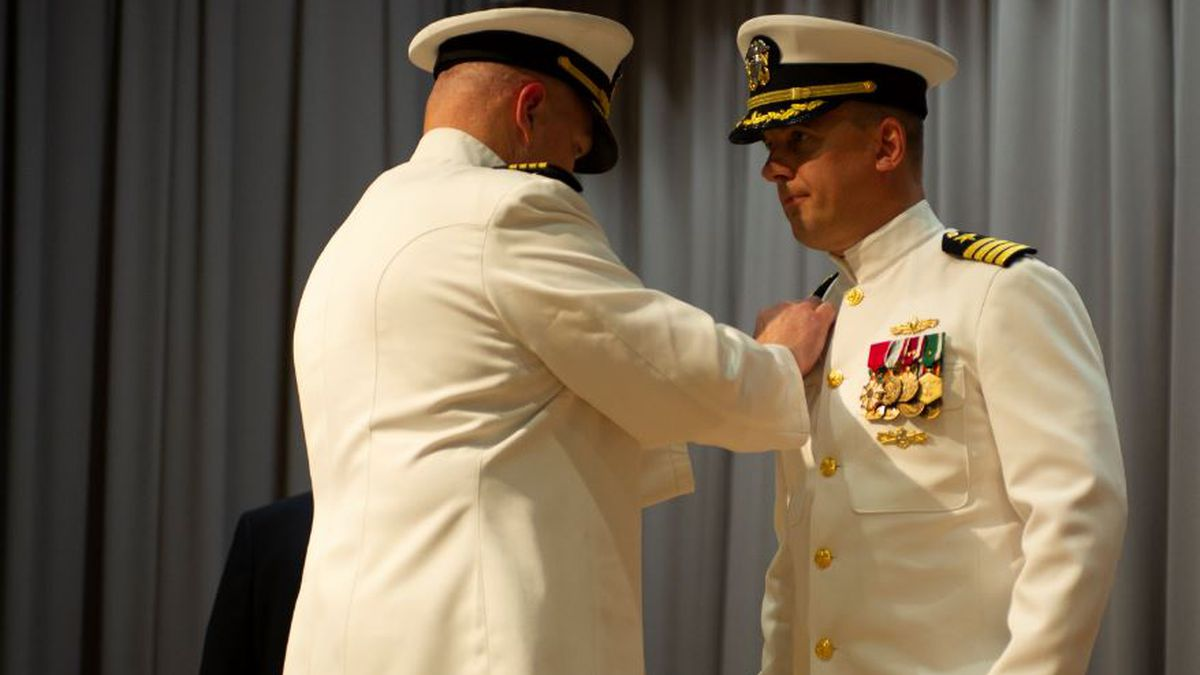 Capt. Brian D. Lawrence, left, pins the Supervisor of Shipbuilding Gulf Coast command pin to the uniform of Capt. Nathan A. Schneider. Schneider assumed command of SSGC during a change of command ceremony Aug. 12. Schneider was previously the executive officer for SSGC. Before serving as executive officer, he served as the Chief of Staff to the Deputy Assistant Secretary of the Navy for ship programs within the office of the Assistant Secretary of the Navy for Research, Development and Acquisition. (U.S. Navy photo by Mass Communication Specialist 3rd Class Kohen S. Gillis)