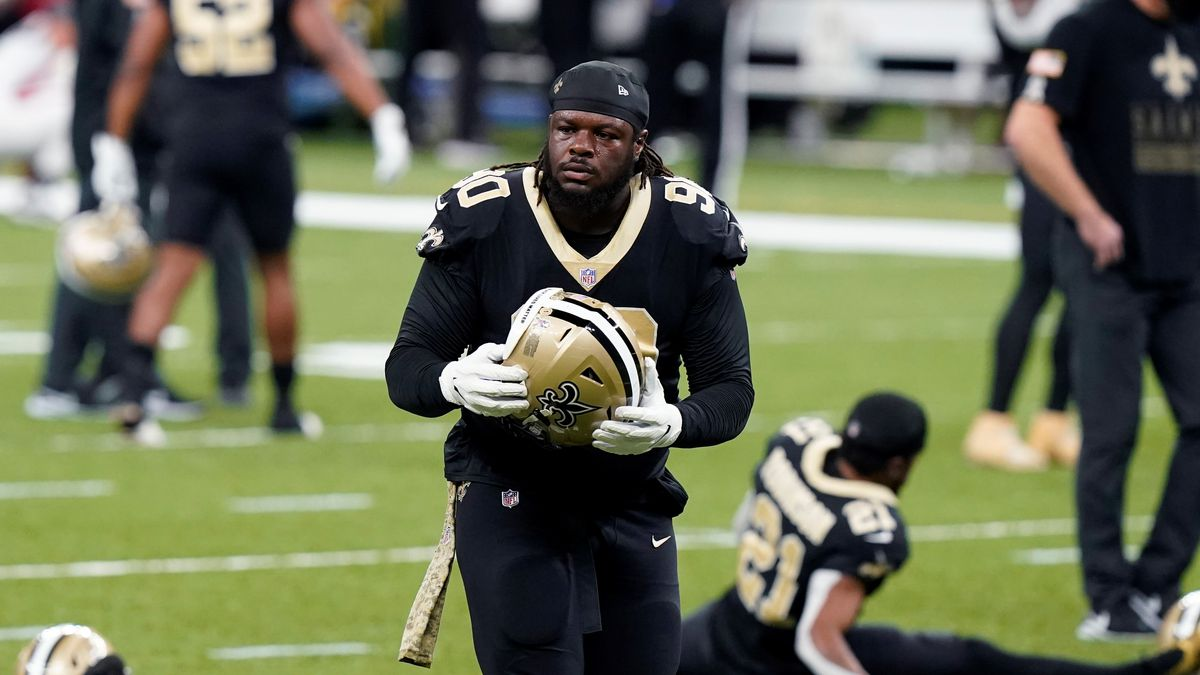 New Orleans Saints defensive tackle Malcom Brown (90) wars up before an NFL football game...