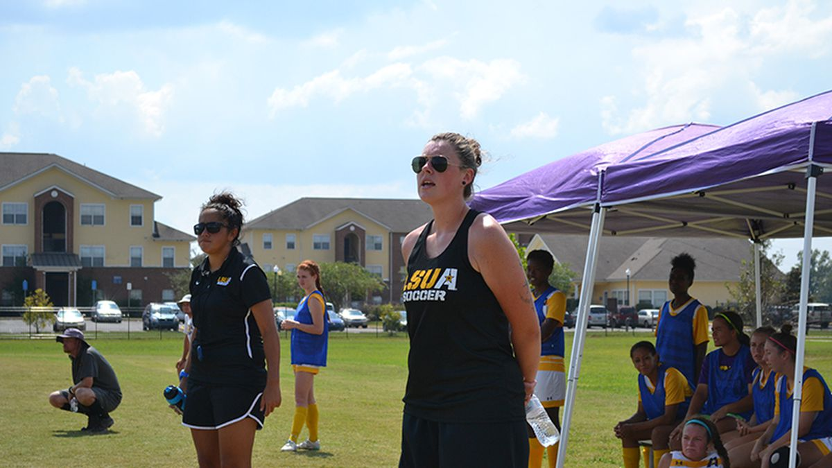 Carla Tejas (wearing black polo shirt & shorts with white trim) while on the coaching...