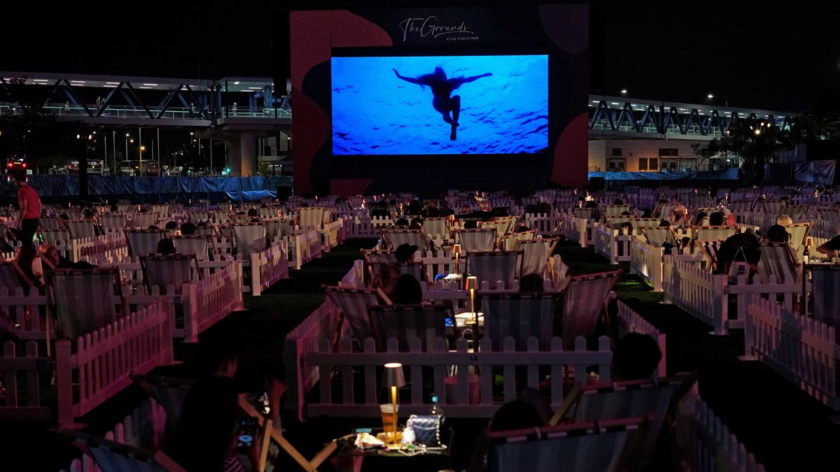 People watch a movie in an outdoor park in Hong Kong Tuesday, Nov. 10, 2020. Hong Kong's first...