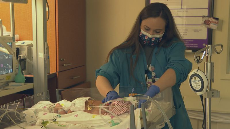 During the Christmas season, the nurses at St. Frances Cabrini Hospital dress the newborns up...