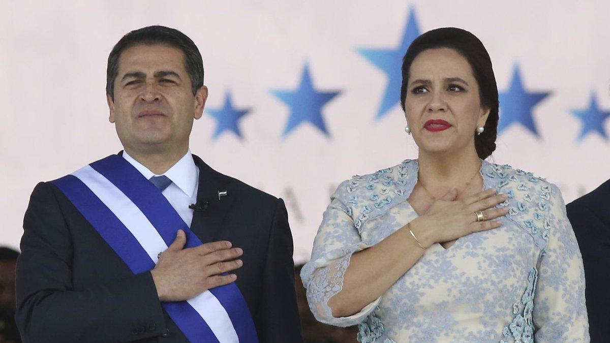 FILE - In this Jan. 27, 2018 file photo, Honduran President Juan Orlando Hernandez, left,...