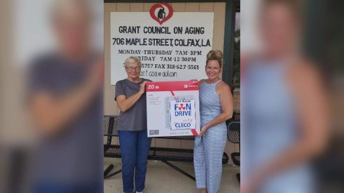 Benita Scroggs (left), executive director of the Grant Council on Aging, and Brittany Brumley, fan drive coordinator, display a fan donated by Cleco during the company's 20th Annual Fan Drive.