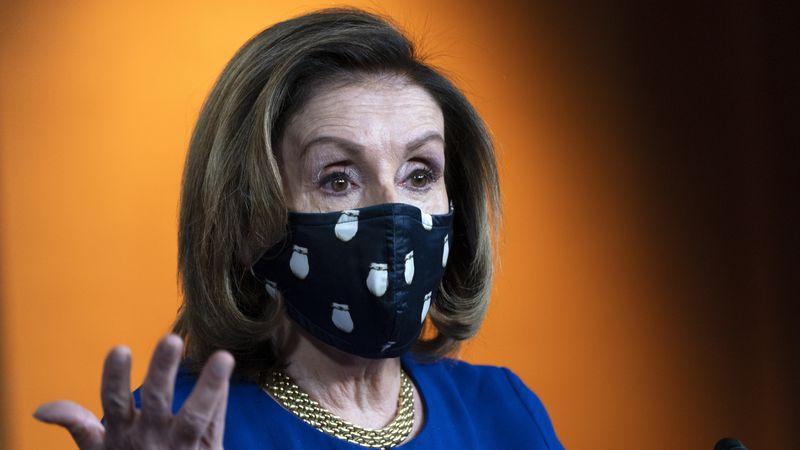 House Speaker Nancy Pelosi of Calif., speaks to the media, Thursday, April 15, 2021, during her...