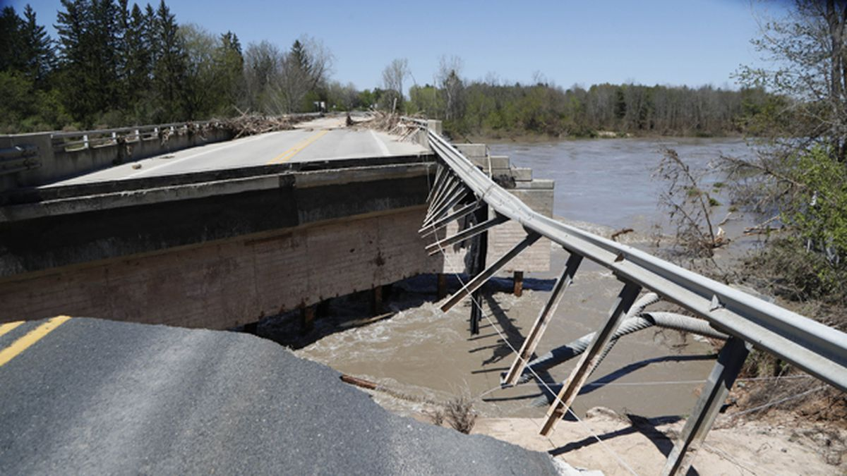 Damage is seen on one of two North M-30 bridges on Wednesday, May 20, 2020, in Edenville, Mich....
