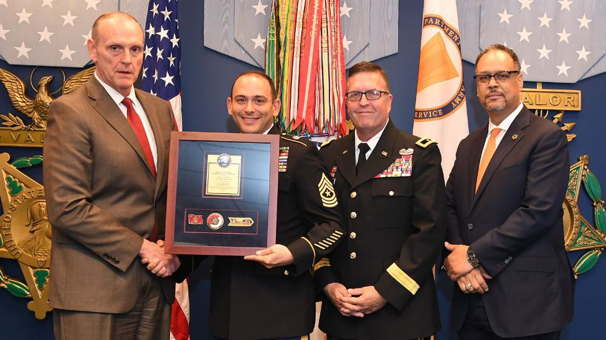 Under Secretary of the Army, Ryan D. McCarthy presented the J5 Senior Enlisted Advisor, Sergeant Maj. David M. Mula, with an award during the eleventh annual Army Lean Six Sigma Excellence Awards Program ceremony at the Pentagon's Hall of Heroes in Washington, DC May 30, 2019. (U.S. Army photo by Spc. XaViera Masline)