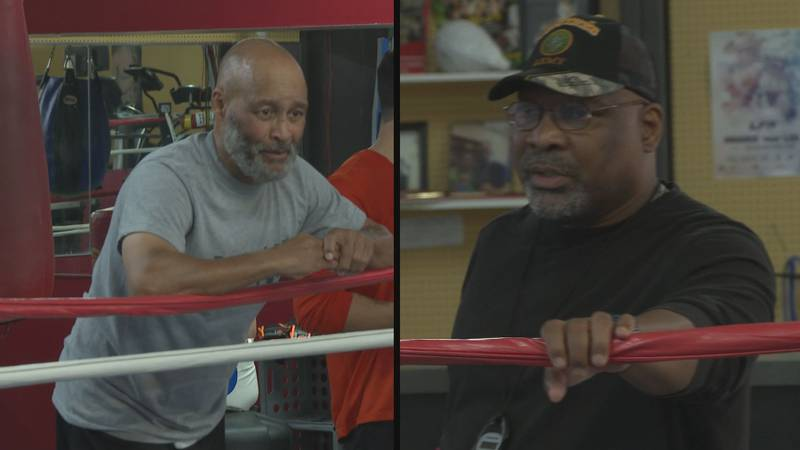 Gerard Aabair (left) and John Scott (right) teaching children life lessons through boxing.
