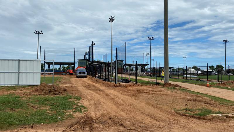 Construction crews are working to finish the four softball fields so they will be ready to play...
