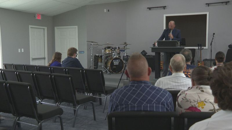 Upper Room Church celebrates their building during praise and worship.