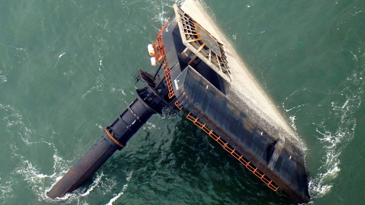 FILE- In this April 18, 2021, file photo, the capsized lift boat Seacor Power is seen seven...