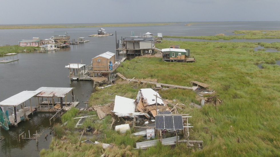 Debris behind camps along the Wilkinson Canal