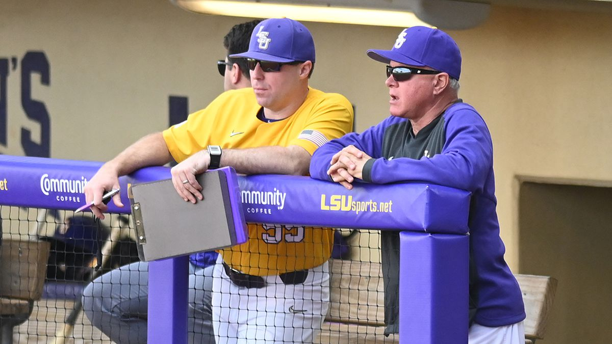 LSU hitting coach Eddie Smith (left) and head coach Paul Mainieri look on during a baseball...