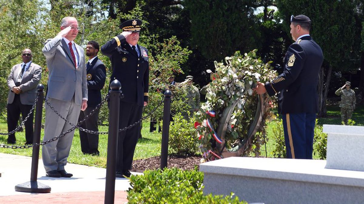 Louisiana Gov. John Bel Edwards and Maj. Gen. Glenn H. Curtis, adjutant general of the Louisiana National Guard, render a salute as Taps is played during an official ceremony memorializing a new monument honoring fallen Louisiana Guardsmen at Louisiana Veterans Memorial Park in Baton Rouge, Louisiana, May 21, 2019. (U.S. Air Force National Guard photo by Master Sgt. Toby Valadie)