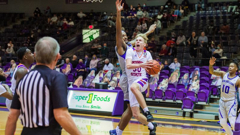 Trenton Massner (with ball) led Northwestern State with 21 points in Wednesday's win against...