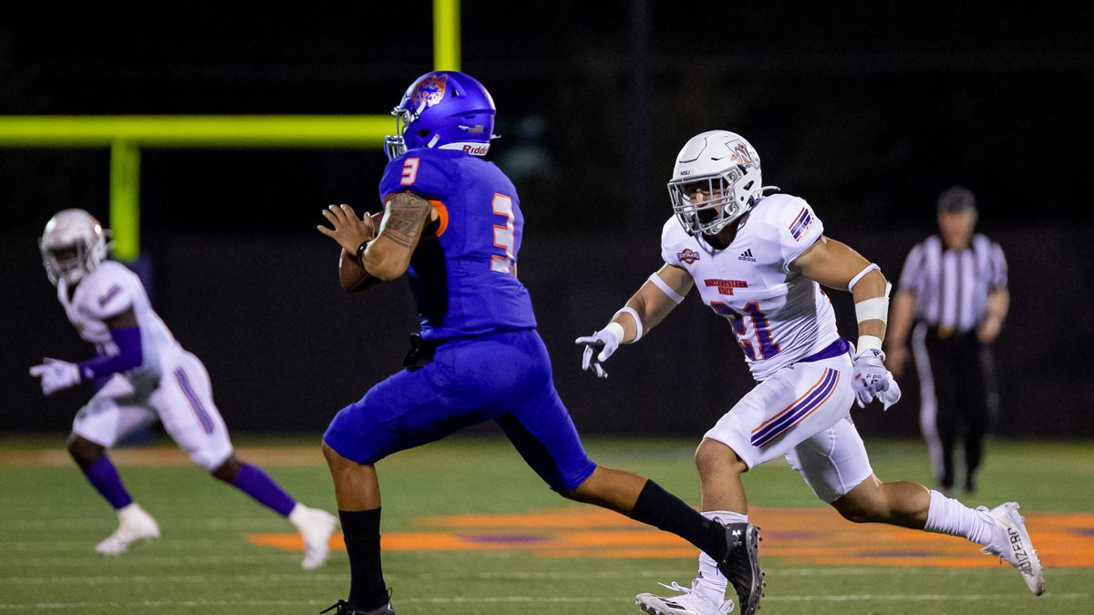 Jared Pedraza (right) chases after Houston Baptist quarterback Orion Olivas in the Demons'...