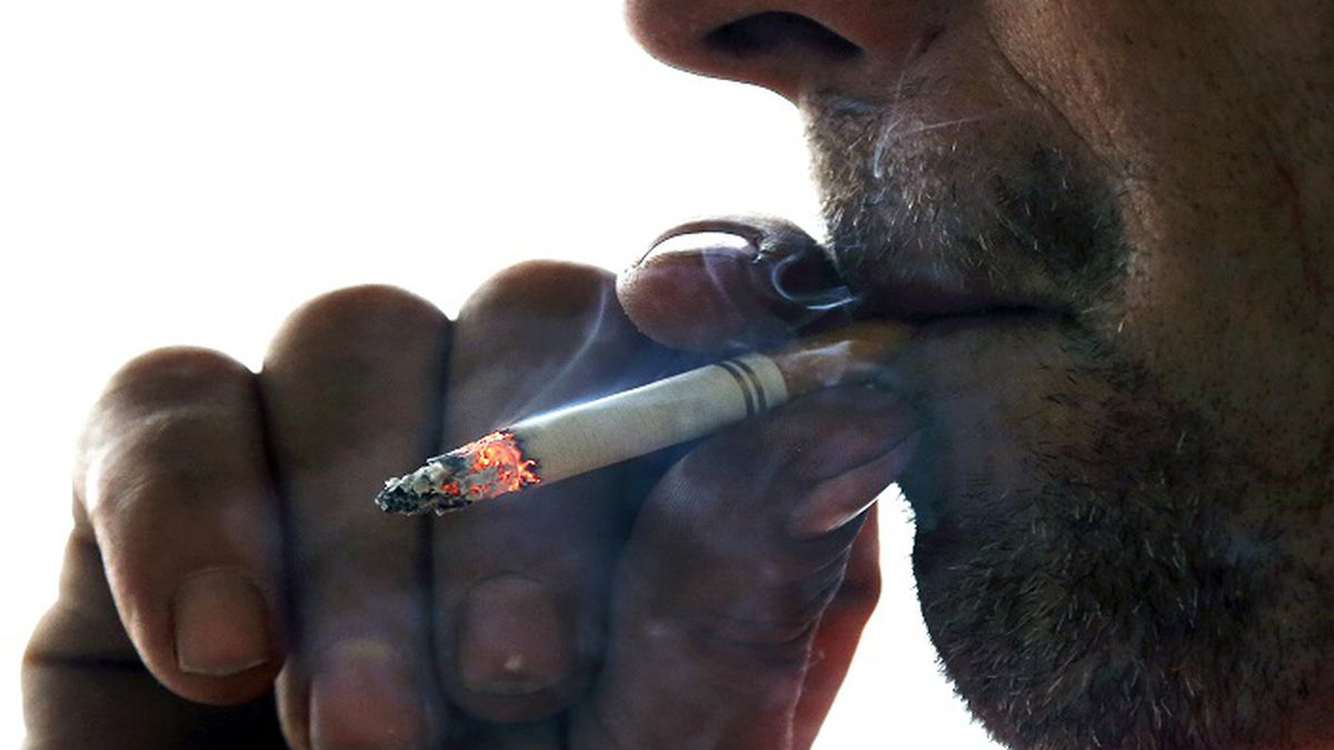 FILE - In this Nov. 6, 2014, file photo, a man smokes a cigarette on Main Street in...