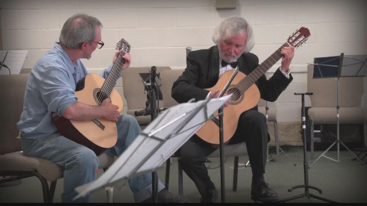 A RLCC inmate plays along with classical guitarist, John Di Chiaro.