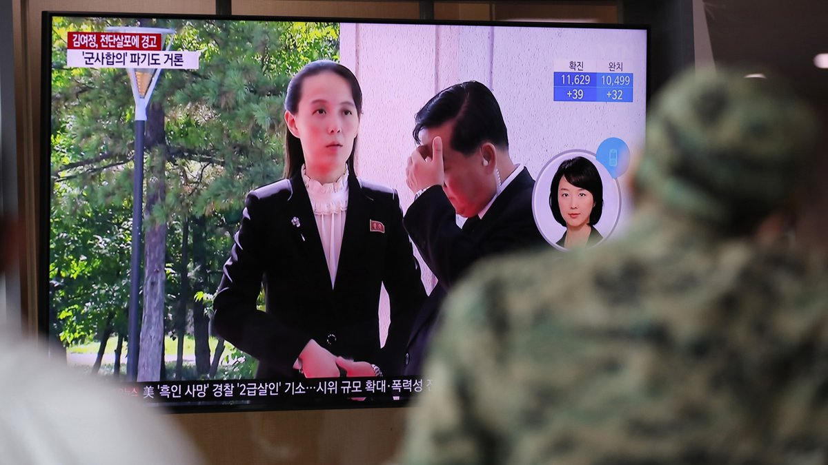 A man watches a TV screen showing a news program with a file image of Kim Yo Jong, the powerful...