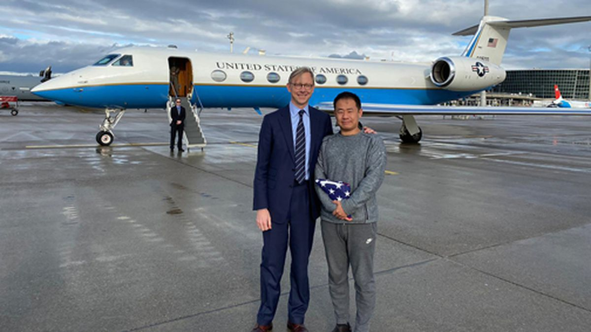 In this photo provided by the U.S. State Department, Brian Hook, U.S. special representative for Iran, stands with Xiyue Wang in Zurich, Switzerland on Saturday, Dec. 7, 2019. (U.S. State Department via AP)