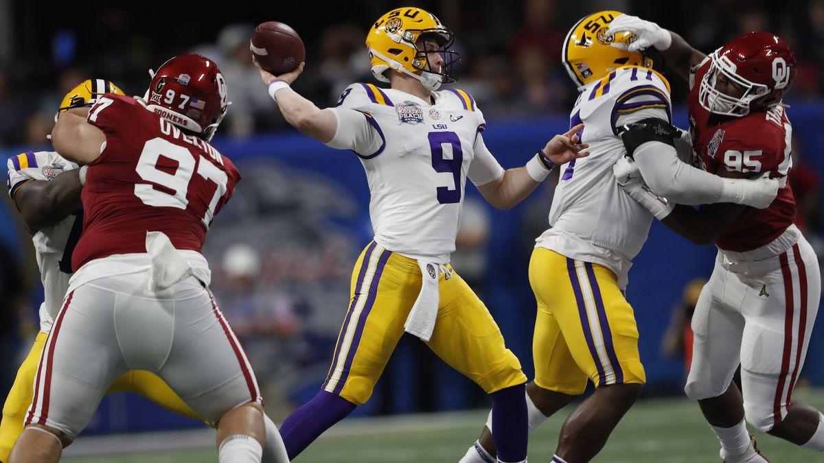 LSU quarterback Joe Burrow (9) works under pressure from Oklahoma during the first half of the Peach Bowl NCAA semifinal college football playoff game, Saturday, Dec. 28, 2019, in Atlanta. (AP Photo/John Bazemore)