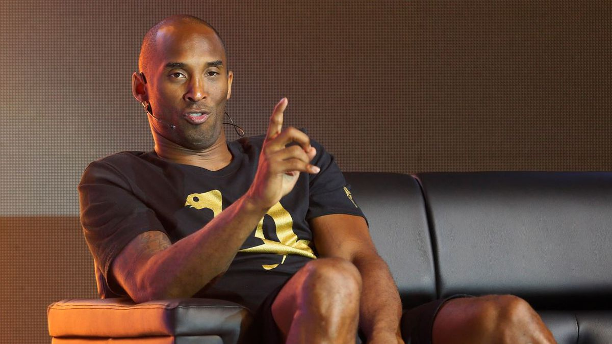 Retired NBA player Kobe Bryant gestures while answering questions from the media during a news...