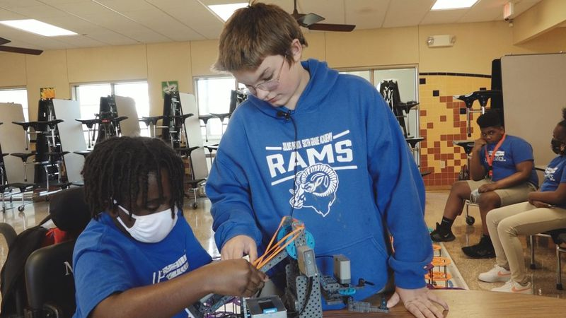 A local robotics team competes at state-level competition.